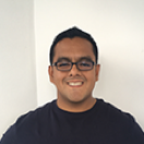 Headshot of Raygun customer and software architect at Healthcare.com, Luis Alonzo